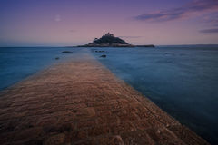 St Michaels Mount. St Michael's Mount, Marazion, Cornwall, England, at dusk, with moon Stock Photos