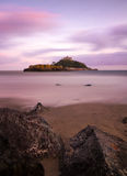 St. Michaels Mount with rocks at dusk, Cornwall. England Royalty Free Stock Images