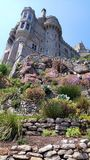 St.Michaels Mount, View from Gardens, Cornwall. Looking up at at St.Michaels Mount from the terraced gardens. The coastal gardens are in tiers with flowering royalty free stock photo