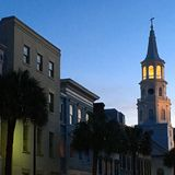 St Michaels's Church glows at dusk in an historic Neighborhood in Charleston South Carolina. The Episcopal church is one of the most recognizable landmarks in Stock Image