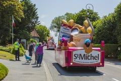 St. Michel Caravan - Tour de France 2015. Sainte Marguerite sur Mer, France - July 09, 2015: St. Michel Madeleines Caravan during the passing of Publicity stock photography