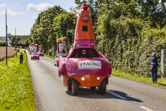 St. Michel Madeleines Vehicles. Illiers-Combray,France- July 21st, 2012: A row of vehicles advertising St. Michel Madeleines during the passing of the Publicity Royalty Free Stock Images