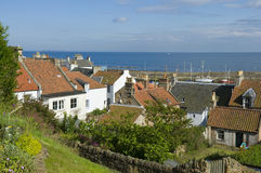St. Monans. View above the picturesque village of St. Monans, East Neuk of Fife, Scotland. The orange-red pantiles, characteristic of the roofs of traditional Royalty Free Stock Image