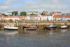 Boats aground at St Monans quayside Royalty Free Stock Images