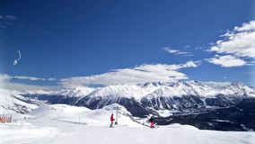 St. Moritz, Switzerland Ski Mountain 2. Time lapse pan R to L of skiers on the mountain above St. Moritz Switzerland stock footage