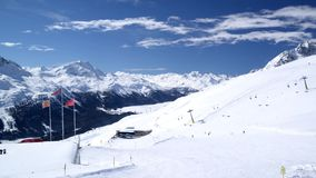 St. Moritz, Switzerland Ski Mountain 1. Time lapse pan R to L of skiers on the mountain above St. Moritz Switzerland stock video