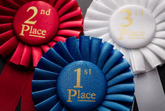 1st, 2nd and 3rd place pleated ribbon rosettes. 1st, 2nd and 3rd place pleated ribbon rosette closeup Stock Photos