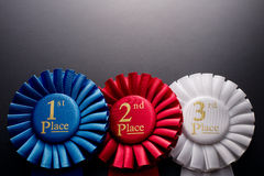 1st, 2nd and 3rd place pleated ribbon rosettes Stock Photos