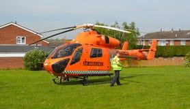 Cambridgeshire air ambulance Helicopter. ST NEOTS, CAMBRIDGESHIRE, ENGLAND - APRIL 30, 2017: Cambridgeshire air ambulance Helicopter landed in housing estate at royalty free stock photos