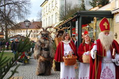 St Nicholas, änglar och krampus Royaltyfri Foto