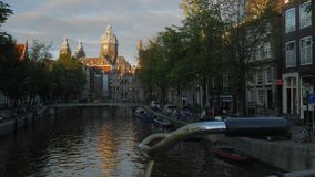 St Nicholas Basilica in Amsterdam at Sunset stock video