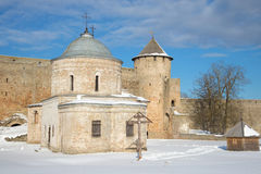 St. Nicholas Church and Gate tower in ancient Russian fortress on the sunny March afternoon. Ivangorod. Russia Stock Image