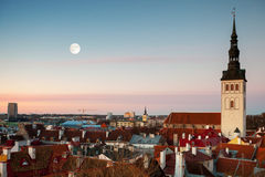 St. Nicholas Church and moon in old Tallinn Royalty Free Stock Photos