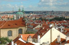 St. Nicholas Church and the red roofs in Prague Stock Images
