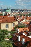 St. Nicholas Church and the red roofs in Prague Stock Photo