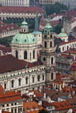 St. Nicholas Church and the red roofs in Prague Stock Photography