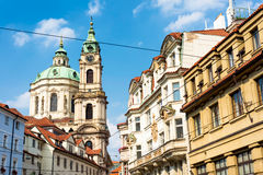 St. Nicholas Church rising up between the narrow streets. Prague Royalty Free Stock Photography