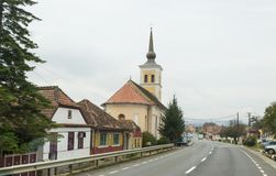 St. Nicholas Church standing on the road passing through the village of Bunesti in Romania Royalty Free Stock Image