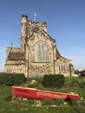 St Nicholas Church, Wallasey. Wirral, with red West Cheshire Sailing Club boat in foreground Royalty Free Stock Image