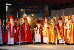 St Nicholas pilgrimage. Men dressed as St. Nicholas gather on a stage in Altötting, Germany during the fifth annual St Nicholas pilgrimage to this town Royalty Free Stock Photography