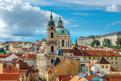 St. Nicolas church and and roofs of Prague Stock Photo