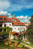 St. Nicolas church and roofs of Prague Stock Image