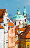 St. Nicolas church and and roofs of Prague Royalty Free Stock Image
