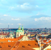St. Nicolas church and and roofs of Prague Stock Photography