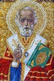 St.Nikolas icon. Detail of St.Nikolas mosaic icon on tombstone Royalty Free Stock Photo