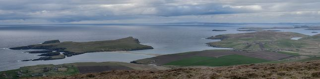 St. Ninian`s Isle Shetland. St. Ninian`s Isle in the Shetland Islands is linked to the mainland by a sand tombolo or natural causeway with the sea on either side Royalty Free Stock Images