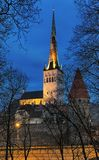 St. Olaf`s Church in Tallinn Old Town in dusk, Estonia Royalty Free Stock Photos
