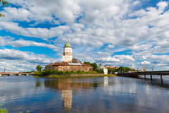 St. Olov castle, old medieval Swedish in Vyborg. St. Olov castle, old medieval Swedish castle in Vyborg, Russia. water in the bay on a sunny summer day Stock Image
