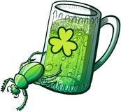 St Paddys Day Beetle pushing a glass of beer Stock Images