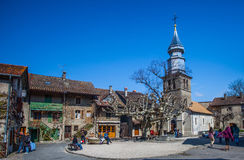 St Pancras Church, Yvoire , France. Yvoire, France. St Pancras church and the village square in Yvoire, France. Yvoire is famous for its well preserved medieval Stock Images