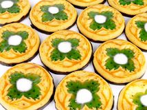 St. Patcrick cookies with clover symbols. On top and chocolate on the bottom Stock Photos
