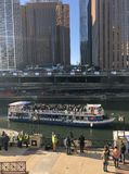 St. Patrick's Day Revelers On Chicago River Tour Boat. This is an early Spring picture of a Chicago River tour boat crowded with St. pateick's Day stock photography