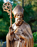 St. Patrick. Statue of St. Patrick with three leaf clover and cross Royalty Free Stock Image
