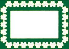 St. Patrick behang met frame en klavers Stock Foto