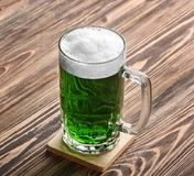 St. Patrick Day concept. Glass of green beer. On wooden background Stock Photo