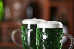St. Patrick Day concept. Glasses of green beer. On blurred background, closeup Stock Photography