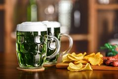 St. Patrick Day concept. Glasses of green beer royalty free stock photography