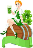 St. Patrick Day girl on the keg Royalty Free Stock Photos