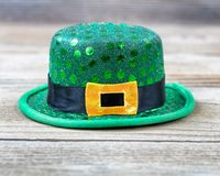 St Patrick Day hat in close up view on rustic wood. Lucky green hat for St Patrick in close up view Stock Photography