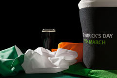St Patrick day with a pint of black beer, hat and irish flag ove Stock Image