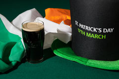 St Patrick day with a pint of black beer, hat and irish flag Royalty Free Stock Photography