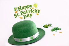 St Patrick day treasure,clover leaf,hat. A St Patrick day scene withclover leaf  and a green hat Royalty Free Stock Images