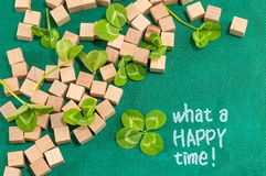 St. Patrick decoration with clover and wooden cubes Stock Image