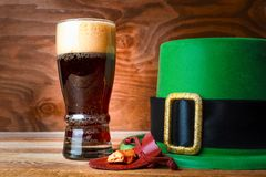 St.Patrick green hat, beer glass and gold Royalty Free Stock Photo