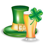 St patrick hat with glass of beer and clover Stock Photo