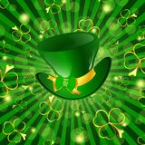 St.Patrick holiday. St.Patrick day theme: hat with bow over green background with shamrocks Royalty Free Stock Image